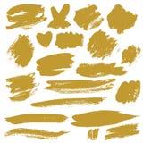 Grunge Brush Stroke. Gold vector illustration set Royalty Free Stock Images