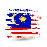Grunge brush stroke with Malaysia national flag royalty free stock photography