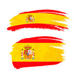 Grunge brush stroke with Spain national flag on white Royalty Free Stock Images