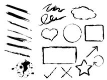 Grunge Brushes. Illustration of brushes and stamps of different shapes with ink blots Stock Photography