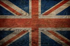 Grunge Brytyjski flaga na drewnianym tle obraz royalty free