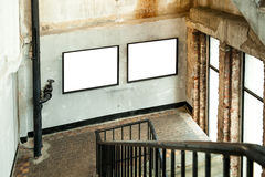 Grunge building with two picture canvas frames Stock Images