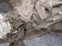 Grunge Burlap Sacks on Asphalt  Stock Photos