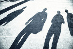 Grunge busy people shadows on city street Stock Photo