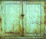Grunge cabinet doors Stock Images