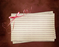 Grunge card with sheet and pink bow Royalty Free Stock Image