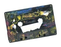 Grunge cassette tape w. free copy space. Painted tape with a sticker for your text, isolated on white background, clipping path Royalty Free Stock Photos
