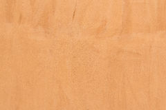 Grunge cement orange color wall. Background Stock Photos