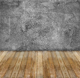 grunge cement wall and yellow wooden floor Royalty Free Stock Photos