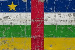 Grunge Central African Republic flag on old scratched wooden surface. National vintage background.  stock images
