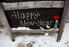 Grunge chalk inscription on the board happy new year Royalty Free Stock Image
