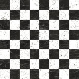 Grunge chessboard. Background that tiles seamless in all directions Royalty Free Stock Photo