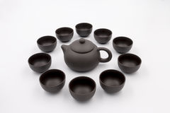 Grunge China teapot and cups stock images