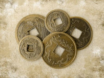Grunge chinese feng shui coins. Chinese feng shui coins for good fortune and success on grunge background Royalty Free Stock Photos