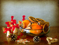 Grunge Christmas: fruits bowl and straw ornaments Stock Photos