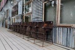 Grunge cinema chairs and old factory royalty free stock images