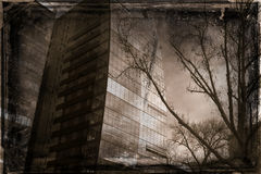 Grunge city textured background. Grunge textured and dark city buildings with winter tree in foreground Royalty Free Stock Photos