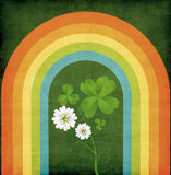 Grunge clover card. Grunge background with four leaves clover and rainbow Stock Images