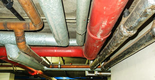 Grunge Colorful Pipeline in The Building. Indoor shot stock photos