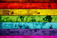 Grunge colorful wood planks background in rainbow colors