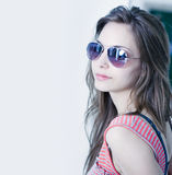 Grunge colorstyled brunette in sunglasses. Stock Photo