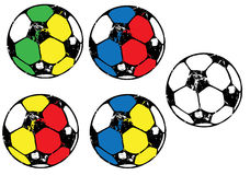 Grunge coloured soccer balls. A set of soccer balls in different colours royalty free illustration