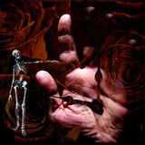 Grunge Composition. With Skeletal figure, time, human hand and roses Royalty Free Stock Images