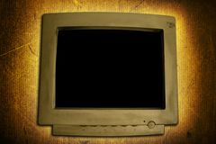 Grunge Computer Monitor. An old computer monitor display on a grunge textured background. Add your own image or text to create your own concept stock photography