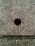 Grunge concrete pipe cover with hole. Drainage. background.  Stock Photography