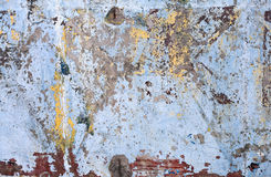 Grunge concrete wall. Texture of vintage grunge concrete wall with peeling color paint Stock Photography