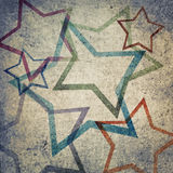 Grunge concrete wall with colorful stars Royalty Free Stock Photo