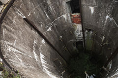 Grunge concrete well interior. Abandoned military silo. Grunge concrete well interior Stock Photography