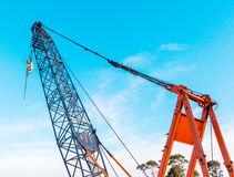 The grunge construction crane for heavy lifting is working in co Royalty Free Stock Image
