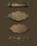 Grunge copper plaques with flourish. Selection of grungy copper plaques and flourishes created in CS3 Royalty Free Stock Image