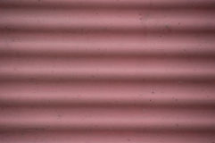 Grunge corrugated faded red pink background closep Stock Image