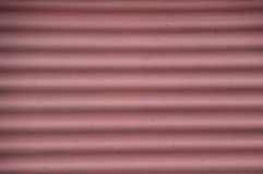 Grunge corrugated faded red pink background Royalty Free Stock Image