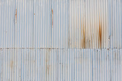 Grunge corrugated grey metal wall background. Stock Photography