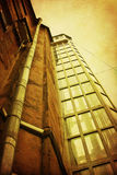 Grunge courtyard with old glass elevator shaft. Dark grunge courtyard with old glass elevator shaft Royalty Free Stock Photo