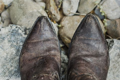 Grunge Cowboy Boots. Looking down at a pair of weathered cowboy boots Stock Images