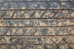 Grunge crack car tire with laterite dirt Royalty Free Stock Photos