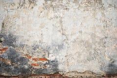Grunge cracked brick stucco wall Stock Image
