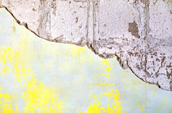 Grunge cracked and chipped paint on an wall. Texture of old plaster damaged brick or concrete wall. Grunge cracked concrete wall. Old vintage wall with plaster Stock Images
