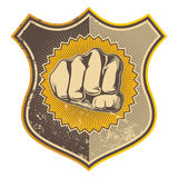 Grunge crest. Grunge crest with stylized fist Stock Photography