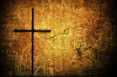 Grunge cross. A cracked yellow grunge wall with metal cross Royalty Free Stock Photos