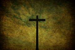 Grunge cross. A cracked yellow grunge wall with metal cross Royalty Free Stock Photo