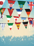 Grunge crowd and world bunting flags Stock Image