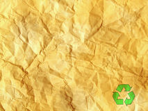 Grunge crumpled old paper with recycle symbol Stock Photo