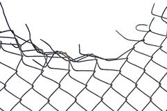 Grunge crushed rusty wire security fence isolated stock photo