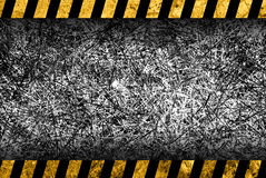 Grunge dark grey background with warning stripes Royalty Free Stock Photography
