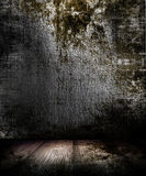Grunge Dark Room. An old dark room with a grunge wall and wood floor Stock Image